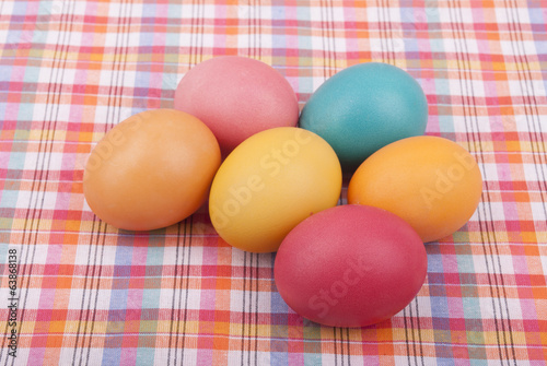 Easter colored eggs on the tablecloth.