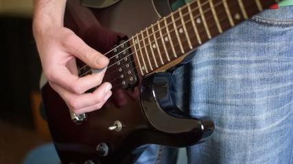 Close up shot of a man playing guitar