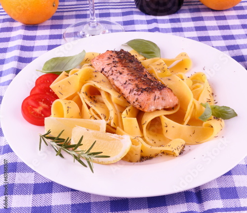 Salmon fillet on tagliatelle, lemon, herbs
