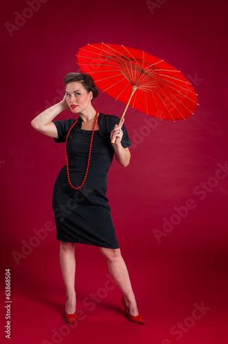 Pinup Girl Poses with Red Umbrella
