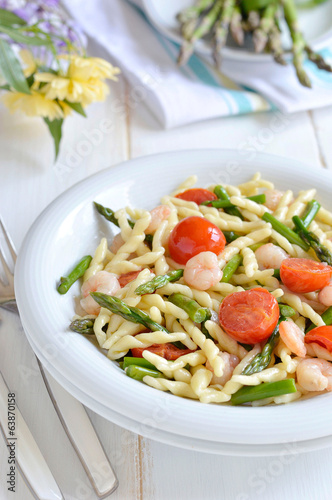Pasta with asparagus and shrimp. Italian food. Close-up.