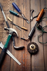 Set of old hand tools on wooden table, work or DIY hobby concept