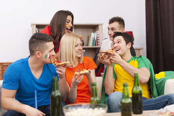 Group of multinational people eating pizza