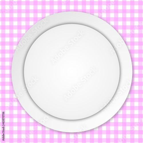 White plate on pink tablecloth