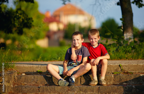 portrait of young friends sitting on stairs