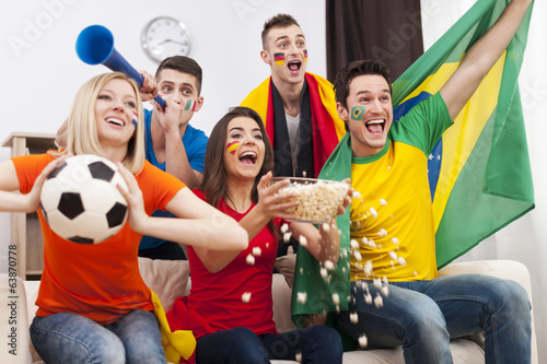 Friends of different nations celebrating goal