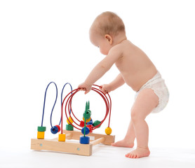 child baby toddler standing and playing wooden educational toy