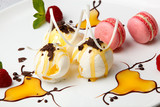 Pink macaroons with vanilla ice cream and honey