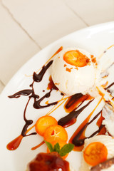 Vanilla ice cream with sliced kumquats
