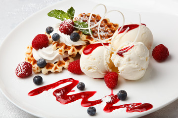Vanilla ice cream and waffles with fresh berries