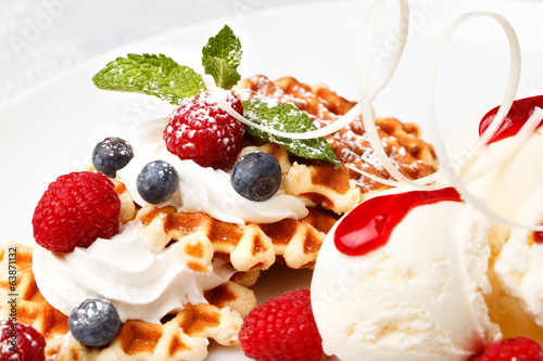 Waffle with vanilla ice cream and fresh berries