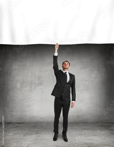 businessman puts a poster