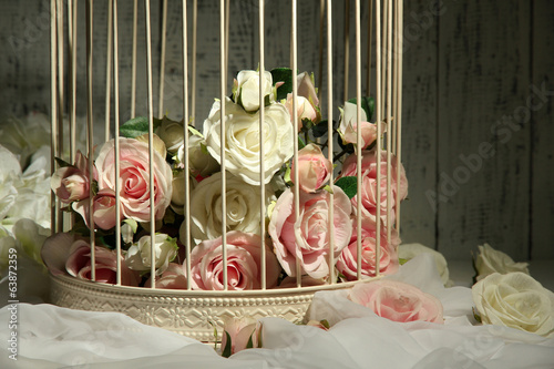 Beautiful decorative cage with beautiful flowers