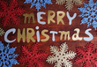Merry Christmas lettering on wooden table close-up