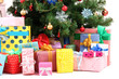 Decorated Christmas tree with gifts, close up,  isolated
