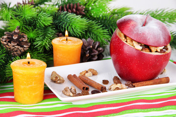 Stuffed Christmas apple with nuts and raisins on table close up