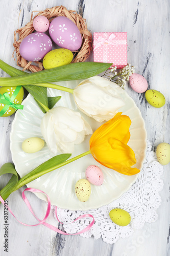 Easter table setting with tulips and eggs