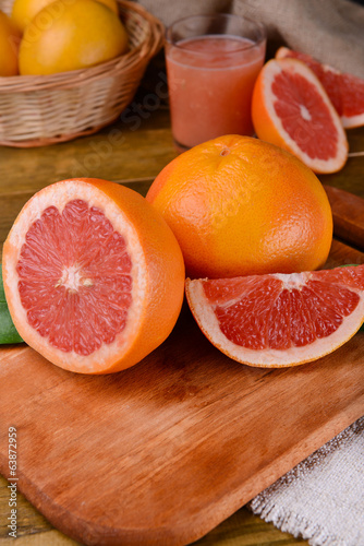Ripe grapefruit on table close-up