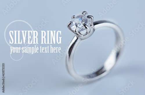Beautiful diamond ring on light background