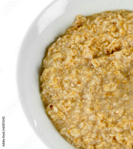Tasty oatmeal isolated on white