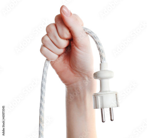 Hand holding electric plug isolated on white