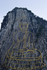Buddha on cliff