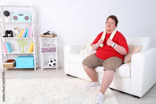 Large fitness man working out  at home
