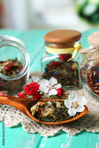 Assortment of herbs and tea in glass jars