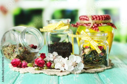 Assortment of herbs, honey and tea in glass jars
