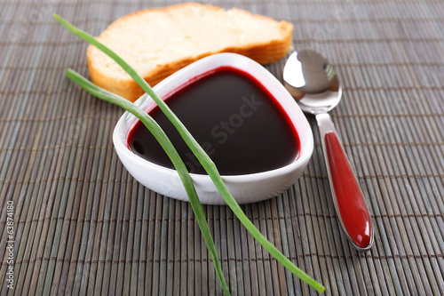 Bowl of beet soup on bamboo background