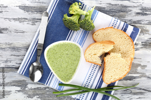 Bowl of broccoli soup on table