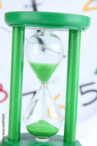 Hourglass on big clock  background