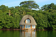 Tropical bungalow over water thatched roof