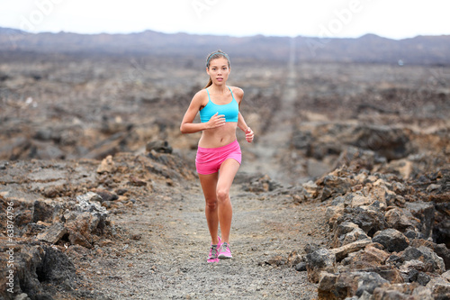 Runner woman triathlete trail running