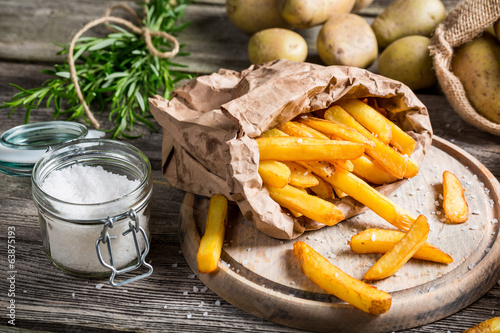 Homemade fries with salt and herbs