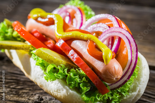 Closeup of homemade hot dog with fresh vegetables