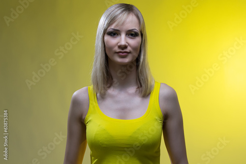 Girl with makeup on yellow background