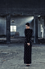 Fashion model posing in abandoned building