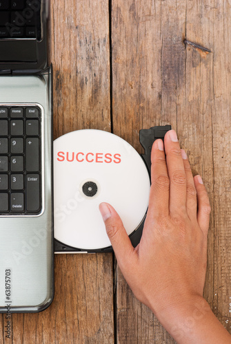 Success concept laptop with compact disk