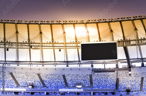 Empty stadium with electronic billboard - 63875954