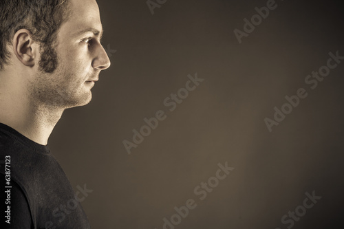 Male portrait on dark background