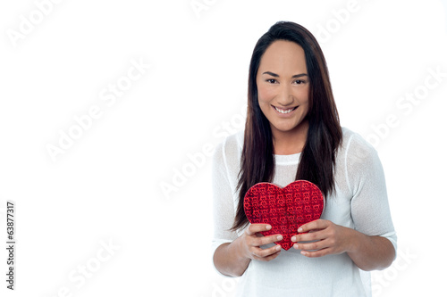 Young happy smiling woman with gift box