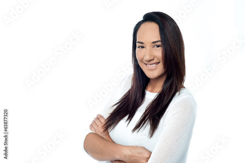 Confident smiling young woman posing