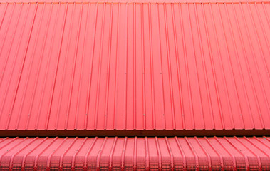 Red corrugated metal sheets roofs