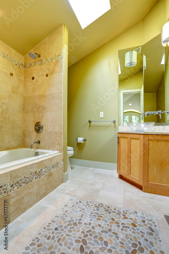 Bathroom with tile and stone trim