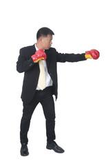 businessman holding boxing gloves up symbolizing conflict