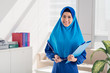 Muslim businesswoman with folder