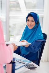Muslim Asian secretary