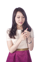Young businesswoman applying mineral powder with make-up