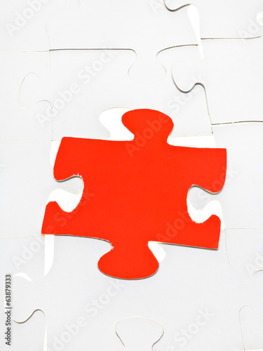 red piece on assembled puzzles